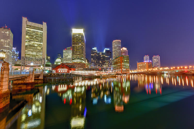 Boston Harbor. In Massachusetts, USA with its mix of modern and historic architecture at night stock photos