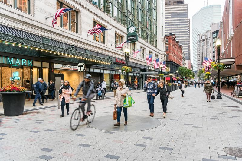 People strolling along a pedstrian street lined with stores and restaurant in Downtown Boston royalty free stock photography
