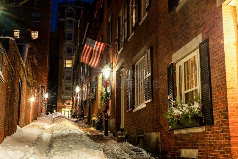 BOSTON, MASSACHUSETTS - JANUARY 03, 2014: Beacon Hill Street in Boston. Long Exposure Night Photography. Acorn Street, Boston stock photography