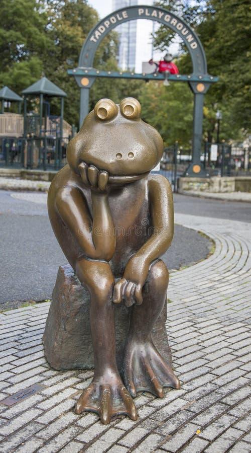 Boston, Massachusetts - October 25, 2018 - Bronze frog overlooks Tadpole Playground. Boston, Massachusetts - October 25, 2018 - Bronze frog overlooks Tadpole royalty free stock photos