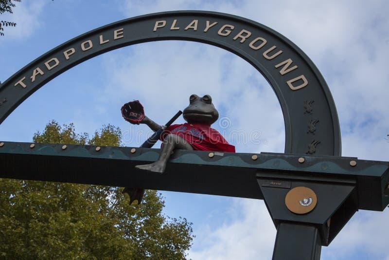 Boston, Massachusetts - October 25, 2018 - Bronze frog overlooks Tadpole Playground. Boston, Massachusetts - October 25, 2018 - Bronze frog overlooks Tadpole royalty free stock images