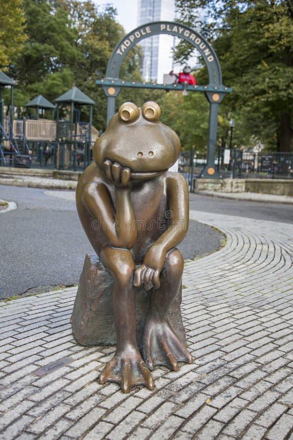Boston, Massachusetts - October 25, 2018 - Bronze frog overlooks Tadpole Playground. Boston, Massachusetts - October 25, 2018 - Bronze frog overlooks Tadpole royalty free stock photography