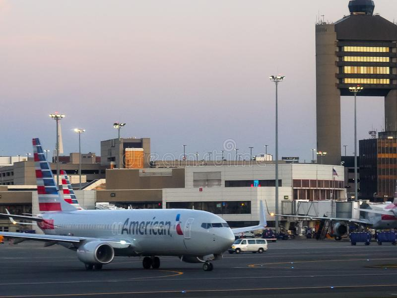 BOSTON, MASSACHUSETTS, USA - OCTOBER, 20, 2017: early morning shot of an american airlines jet taxiing at boston airport stock image
