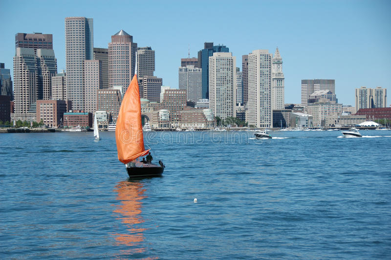Boston Skyline. Beautiful skyline of boston with sailing boat in front of stock photography