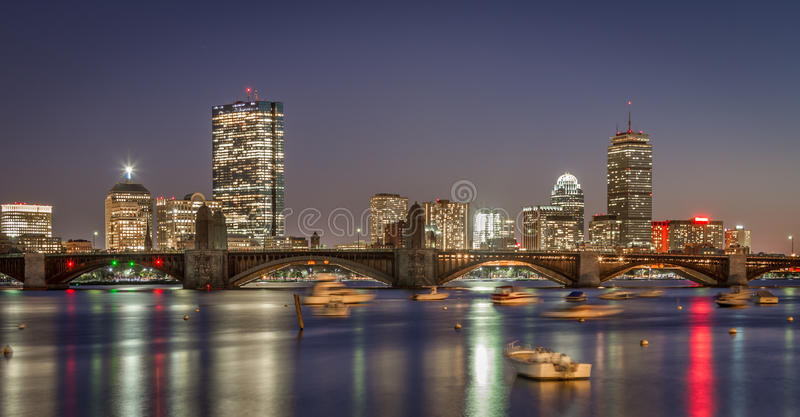 Boston skyline and the Longfellow bridge in sunset. View of downtown Boston a calm fall day. Long exposure to capture the vibrant city reflection in the Charles royalty free stock image