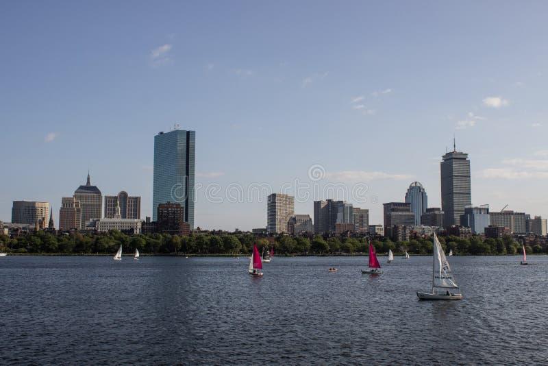 Boston Skyline and Sailboats along Charles River stock images