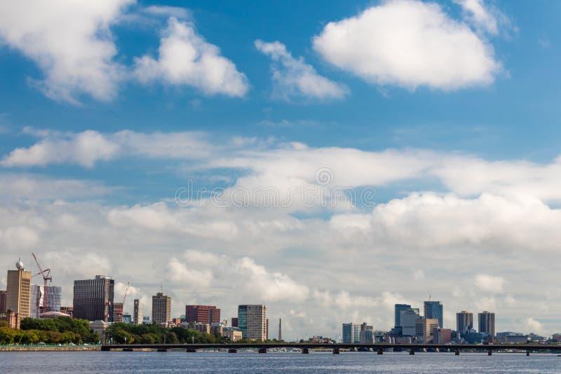 Boston skyline on a sunny day looking across the Charles River at the Harvard Bridge. Horizontal aspect stock photos