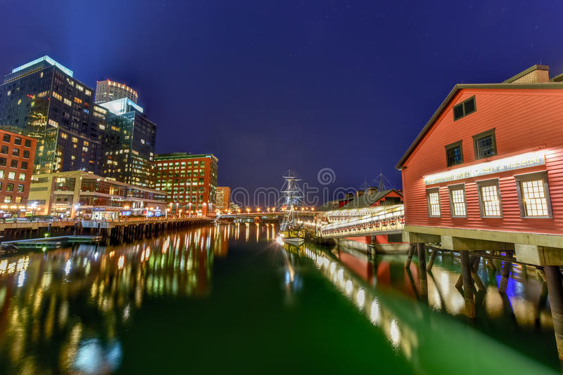 The Boston Tea Party Museum. In Boston Harbor in Massachusetts, USA with its mix of modern and historic architecture at night stock photo