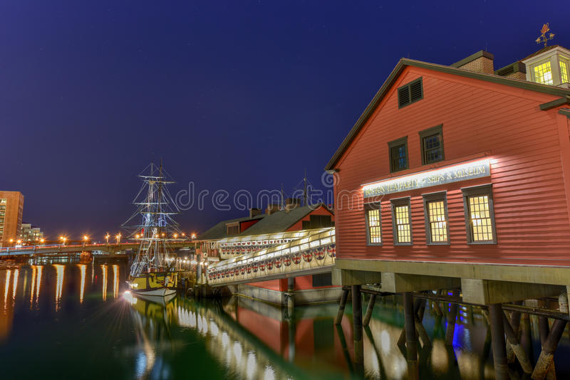 The Boston Tea Party Museum. In Boston Harbor in Massachusetts, USA with its mix of modern and historic architecture at night stock image