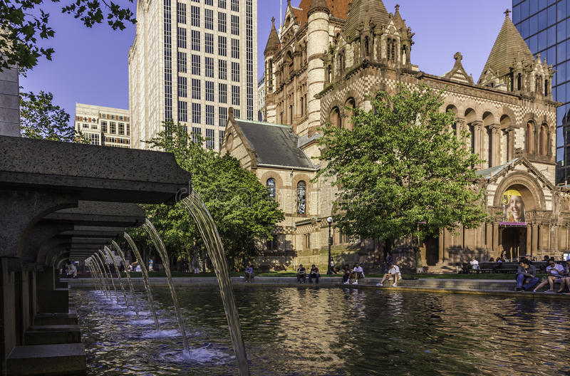 Boston. View of Copley Square in Boston, Massachusetts, USA showcasing its mix of modern and historic architecture with some locals and tourists passing by and stock photo