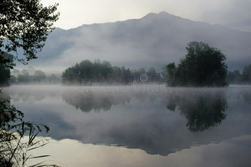 Bosy of Water Surrounded by Mist royalty free stock photos