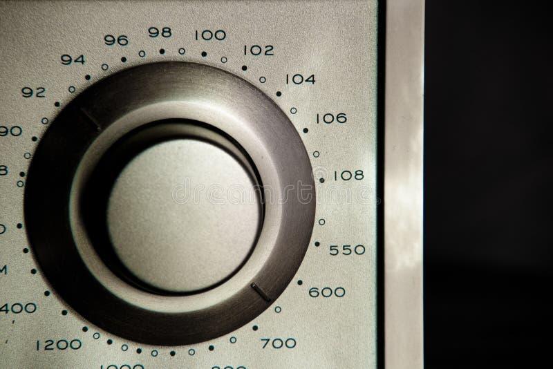 Botão a ajustar em seu rádio favorito imagens de stock