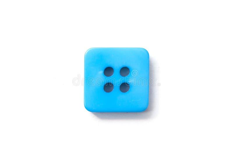 Botão quadrado azul da costura no fundo branco fotografia de stock royalty free