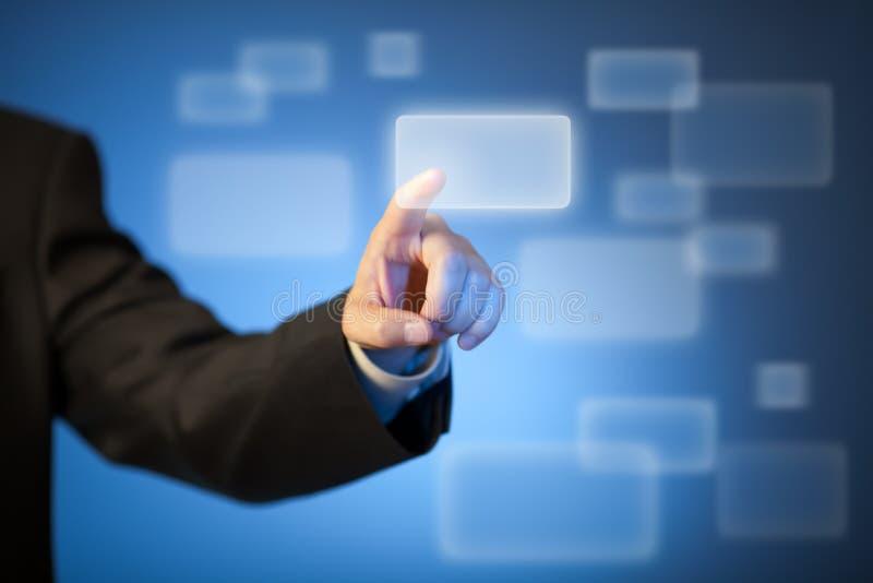 Botón abstracto del presionado a mano en pantalla táctil foto de archivo libre de regalías