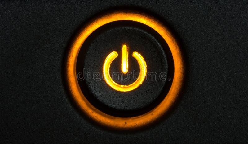 Botón anaranjado de la potencia que brilla intensamente imagen de archivo libre de regalías