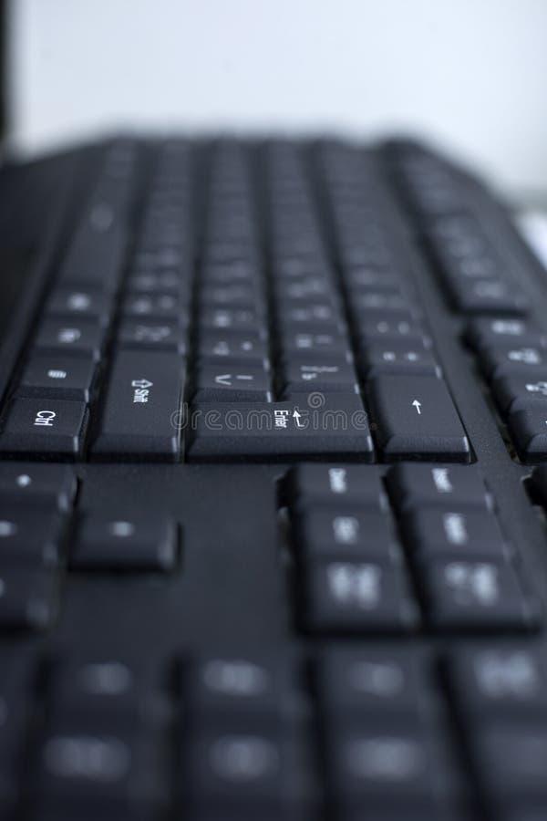 Botón atado con alambre ordenador negro del teclado foto de archivo