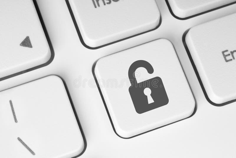 Botón de bloqueo abierto en el teclado imágenes de archivo libres de regalías