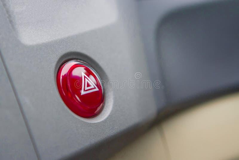 Botón de la emergencia en coche con zona negra fotografía de archivo libre de regalías