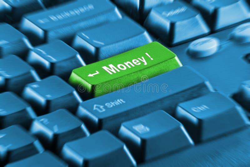 Botón del dinero verde en un teclado azul fotos de archivo