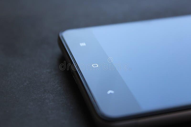 Botón del sensor de Smartphone imagenes de archivo