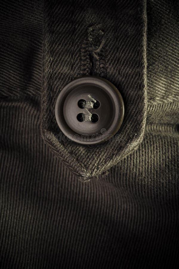 Botón en la ropa - concepto de la manera fotos de archivo libres de regalías