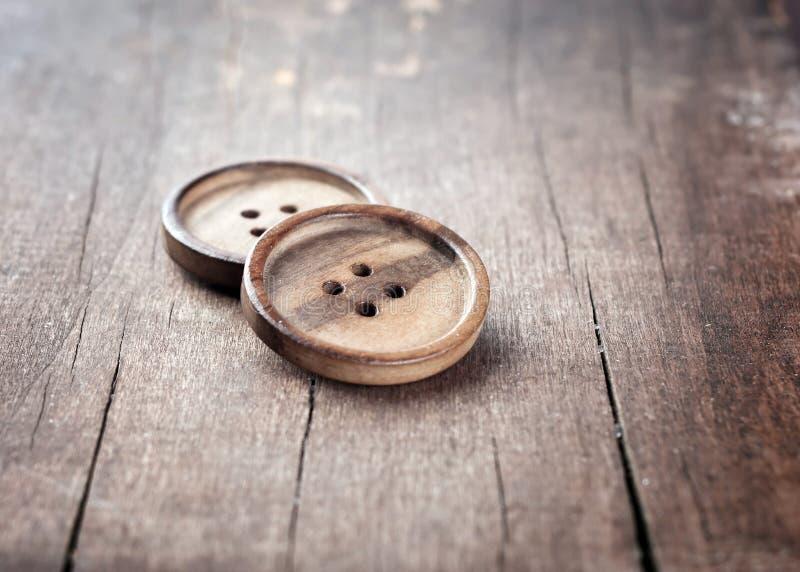 Botón en un vector de madera fotografía de archivo