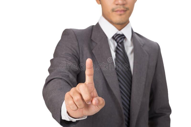 botón imaginario de la prensa del hombre de negocios en interfaz de la pantalla táctil fotos de archivo libres de regalías
