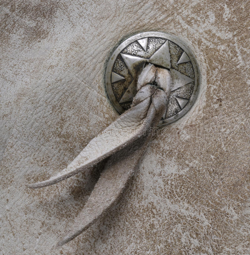 Botón occidental de Concho en el cuero imagenes de archivo
