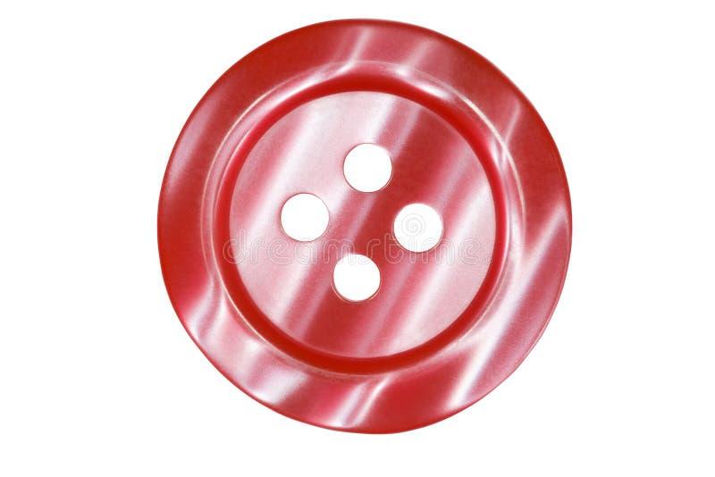 Botón rojo oscuro para la ropa aislada imagen de archivo