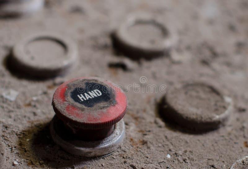 Botón viejo del panel de control de la fábrica fotografía de archivo libre de regalías