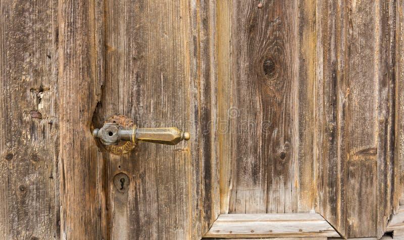 Botón viejo en puerta de madera del vintage foto de archivo libre de regalías