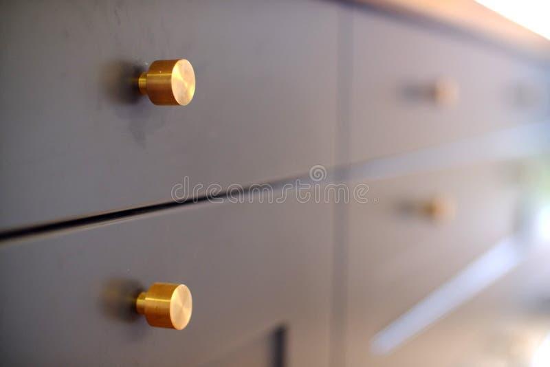 Botões de bronze da cozinha imagens de stock