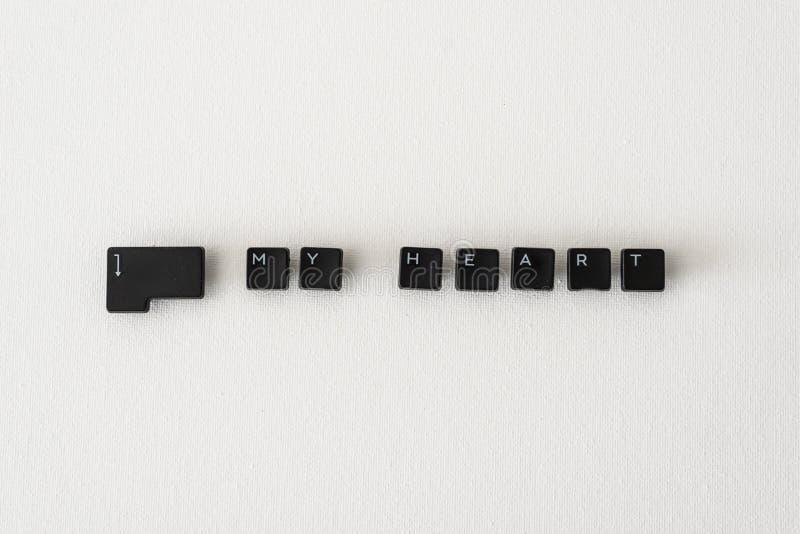 Botões do teclado no fundo neutro para incorporar meu coração imagens de stock
