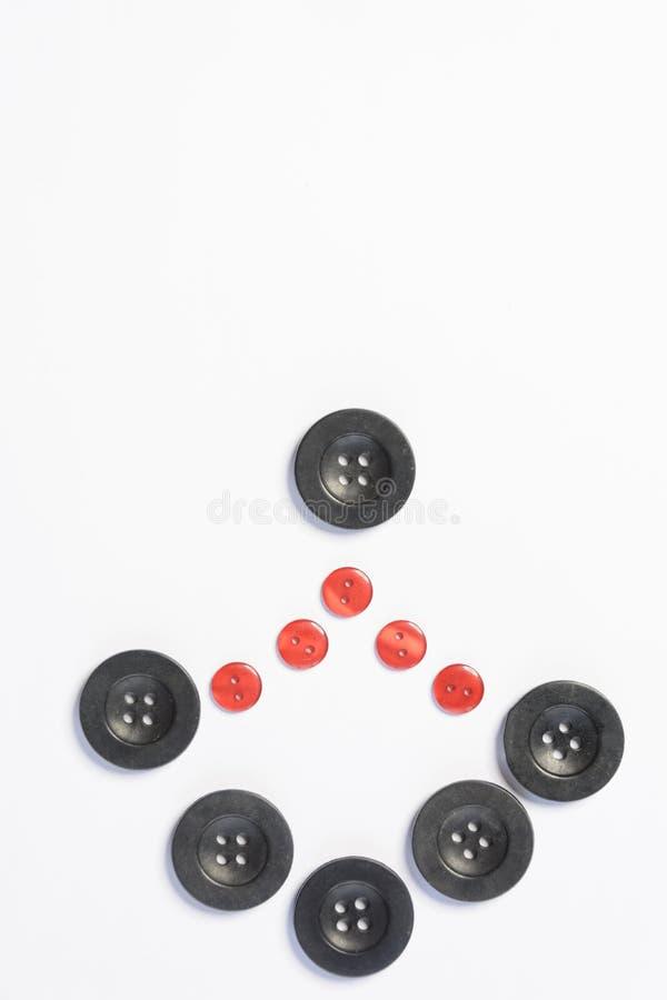 botões pretos para costurar em um fundo branco fotos de stock