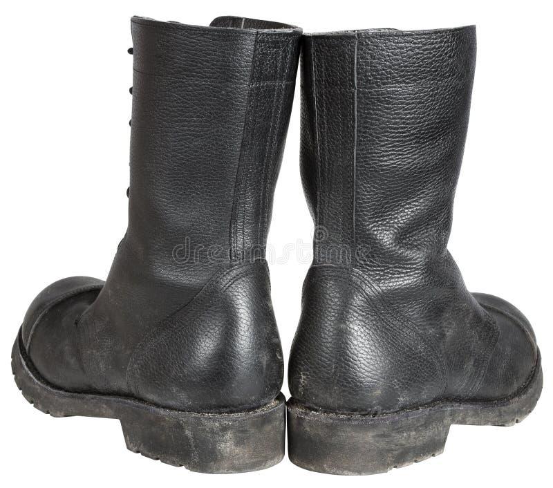 Bota militar, lado trasero posterior de los zapatos del negro del ejército en blanco imagen de archivo libre de regalías