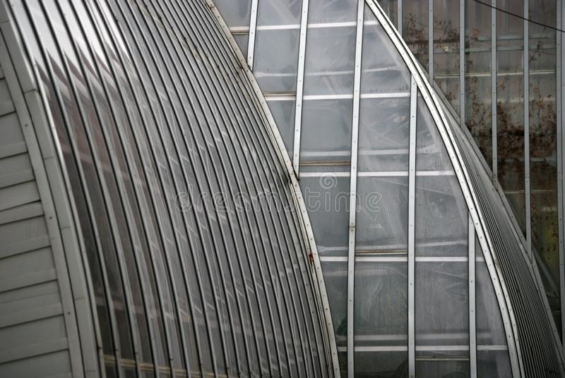 Botanisk trädgårdbyggnaden, exponeringsglasfasadväxthus Stiliserad tappning royaltyfria bilder