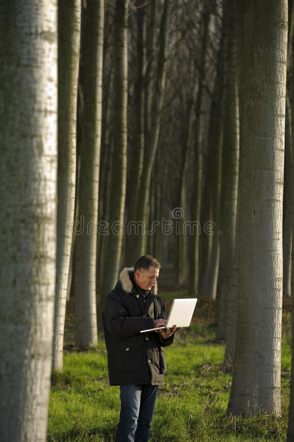 Download Botanist Working Outdoors Royalty Free Stock Image - Image: 26572306