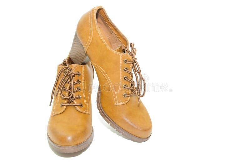 Botas amarelas da forma das mulheres imagem de stock