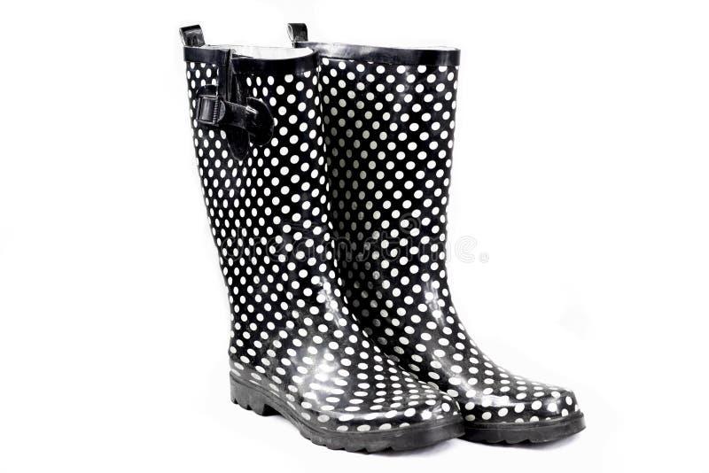 Botas de chuva da mulher imagens de stock royalty free