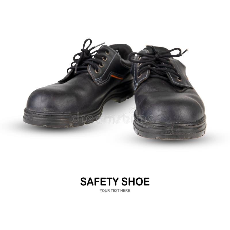 Botas del trabajo del negro de zapato de seguridad en el fondo blanco foto de archivo libre de regalías