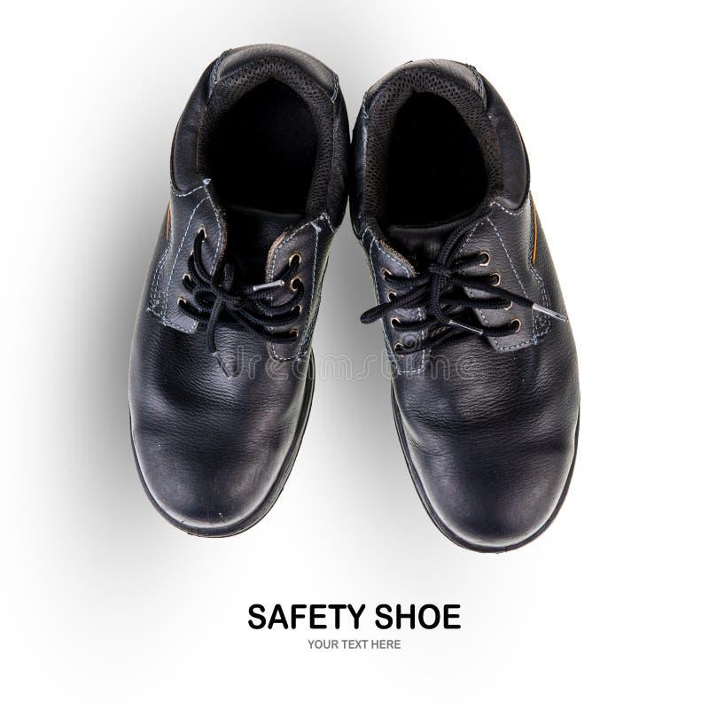 Botas del trabajo del negro de zapato de seguridad en el fondo blanco imagen de archivo libre de regalías