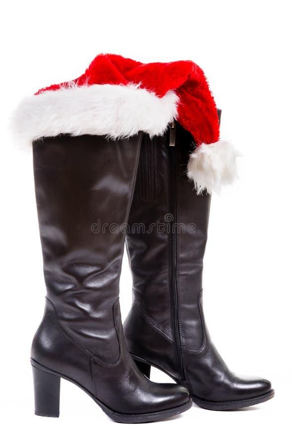 Botas pretas com chapéu de Santa foto de stock