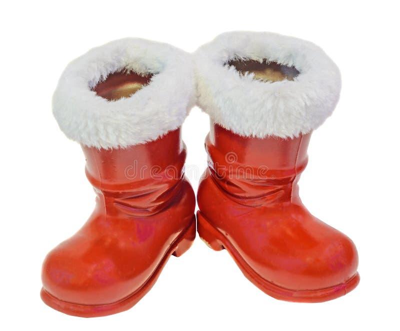 Botas vermelhas de Santa Claus, sapatas A São Nicolau carreg presentes, fundo branco imagens de stock royalty free