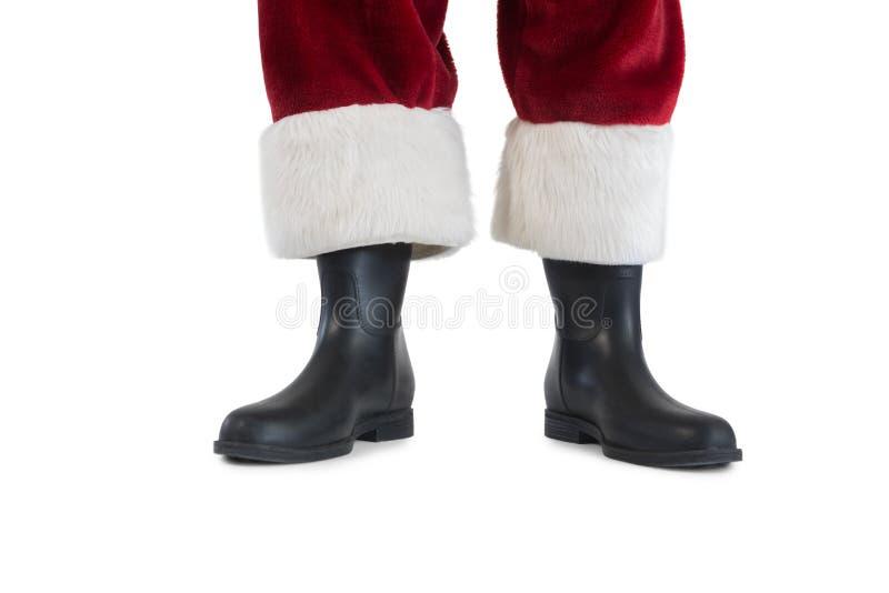 Botas y piernas de Christmas del padre imágenes de archivo libres de regalías