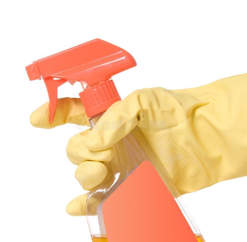 Botella con guantes del aerosol del disparador de la explotación agrícola de la mano imagen de archivo