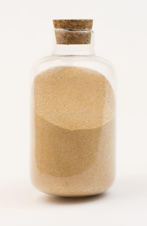 Botella con la arena fotos de archivo libres de regalías