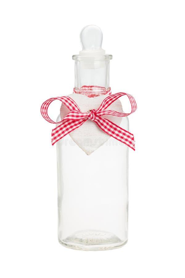 Botella con la etiqueta en forma de corazón imagen de archivo libre de regalías