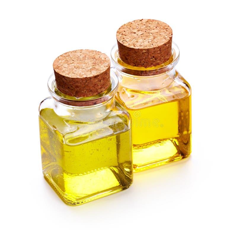 Botella de aceite del masaje y de jabón líquido fotografía de archivo