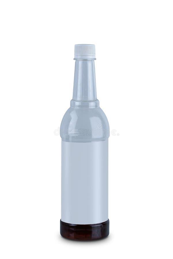 Botella de agua del plástico transparente aislada en el fondo blanco imagen de archivo