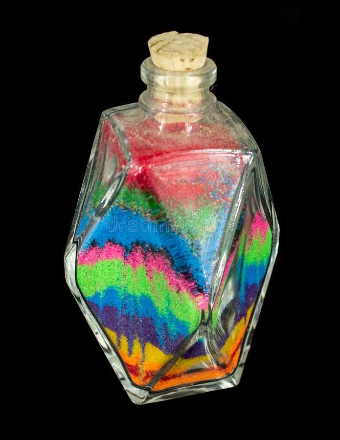 Botella de arena del arco iris fotografía de archivo